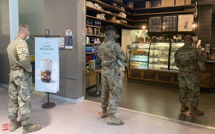 Soldiers on Tower Barracks inside the post exchange Starbucks, in Grafenwoehr, Germany, could move to Italy under the plan announced by Defense Secretary Mark Esper on Wednesday, July 29, 2020, to withdraw nearly 12,000 U.S. troops from Germany.