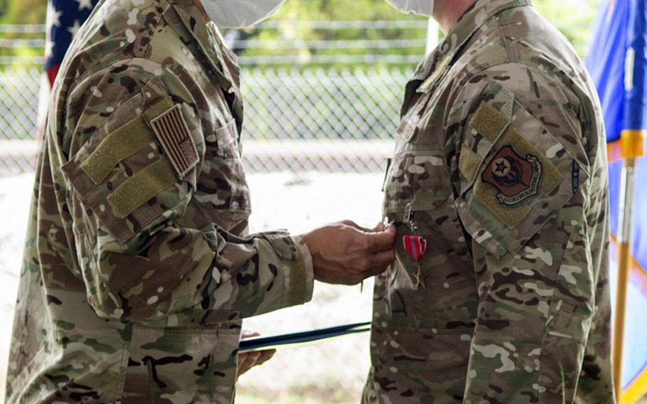 A Bronze Star Medal is presented to an Air Force Special Tactics operator from The 21st Special Tactics Squadron assigned to Pope Field, N.C. The squadron held a ceremony July 24, 2020, to present over 90 awards for the squadron's most recent deployment in 2019.
