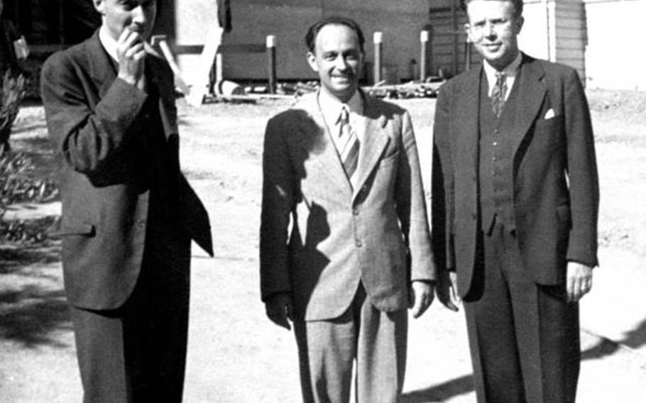 Pioneers of atomic science in the United States shown in this undated photograph are, from left, J. Robert Oppenheimer, Enrico Fermi and Ernest Lawrence.