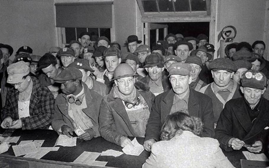 Workers at the Hanford, Wash., Engineer Works send money home in this undated photograph.