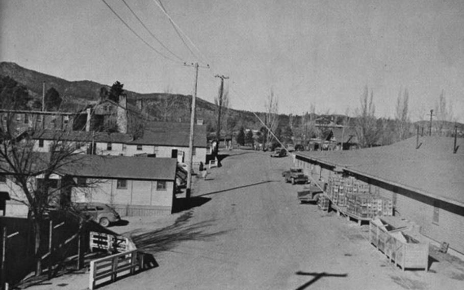 This undated photograph shows a street view of Los Alamos during the Manhattan Project era.
