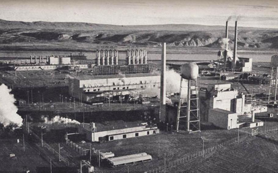 The F Reactor plutonium production complex at Hanford, Wash., is depicted in an undated photograph from the Manhatta Project era. The boxy building between the two water towers on the right is the plutonium production reactor.