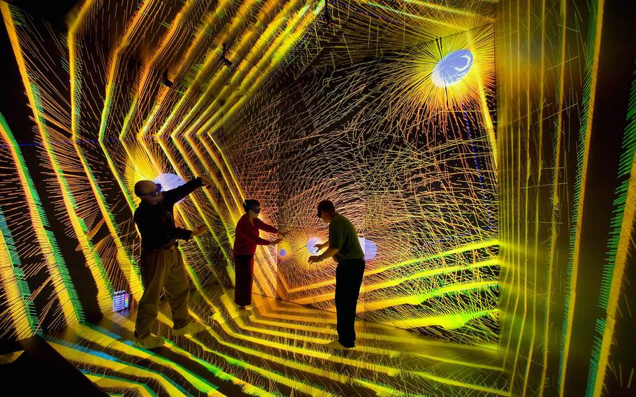 Researchers inspect an astronomical simulation at the Los Alamos SuperComputing Center on Nov. 29, 2006.