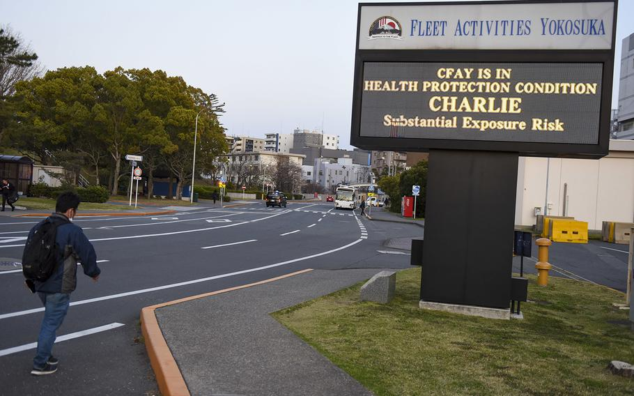 A sign displays the health-protection condition in late March at Yokosuka Naval Base, Japan.