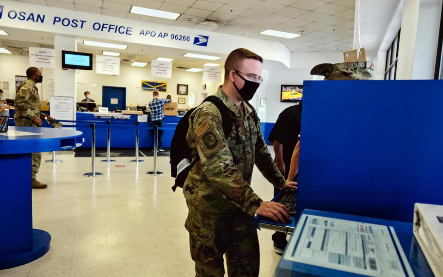 Staff Sgt. Dustin Traylor of the 51st Fighter Wing uses a computer to fill out a customs form inside the post office at Osan Air Base, South Korea, June 16, 2020.
