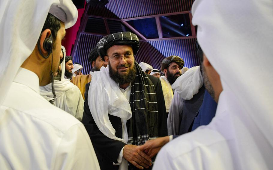 A Taliban official greets others Feb. 29, 2020, in Doha, Qatar, after the group signed a deal with the U.S. that would lead to a withdrawal of foreign forces if the Taliban meets certain conditions. Afghan government officials are expected to depart Thursday for Doha to begin talks with the Taliban.