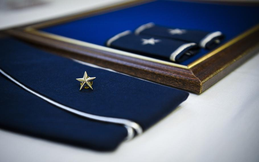 A flight cap with brigadier general rank rests on a desk during a promotion ceremony at Hurlburt Field, Fla., June 8, 2020. A recent Rand Corp. study said the armed services trains and promotes its flag officers in different ways.