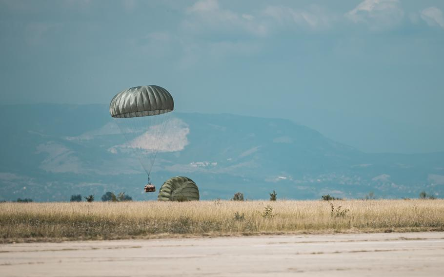 A container delivery system falls to the drop zone during exercise Thracian Summer at Cheshnegirovo landing zone, Bulgaria, Aug. 19, 2020.