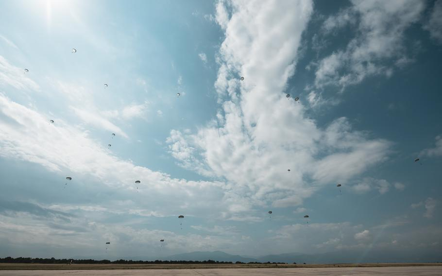 Bulgarian parajumpers head to the ground after jumping from U.S. Air Force C-130J Super Hercules and Bulgarian C-27J Spartan aircraft during the Thracian Summer exercise at Cheshnegirovo landing zone, Bulgaria, Aug. 19, 2020.