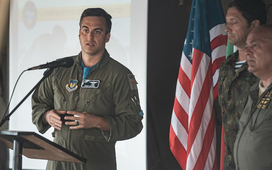 U.S. Air Force Maj. Derek Andeweg, 37th Airlift Squadron aircraft instructor pilot, explains training operations to Bulgarian government officials and military members during the exercise Thracian Summer at Cheshnegirovo landing zone, Bulgaria, Aug. 19, 2020.