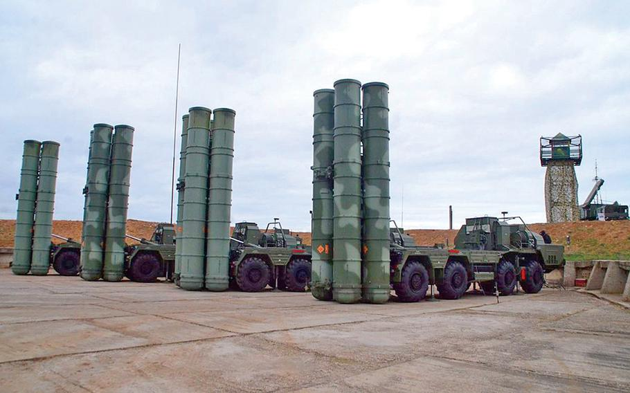 Russian S-400 surface-to-air missile launchers are seen in Sevastopol in 2018. Russia plans to deliver a second S-400 surface-to-air missile system to Turkey, despite warnings from Washington that Ankara faces sanctions if it deploys the system, Russian state news reported.