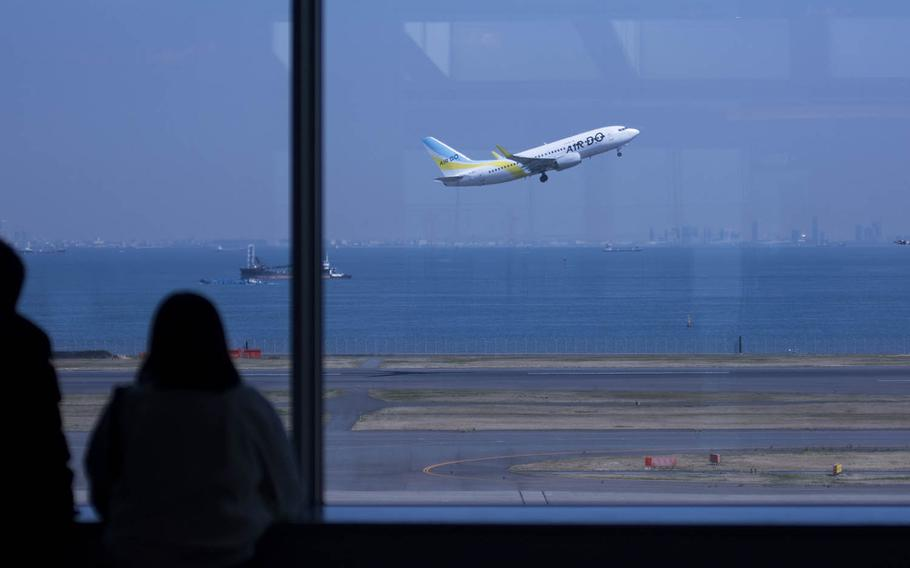 A flight takes off from Haneda International Airport in central Tokyo, March 18, 2020. Akifumi Ishikawa/Stars and Stripes