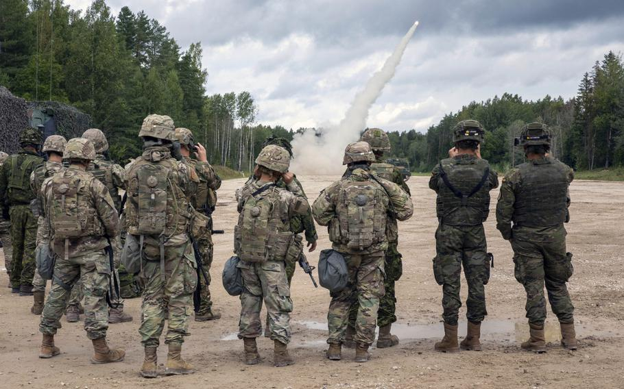 U.S. soldiers, along with Estonian Defense Force troops and other NATO allies and partners watch as a rocket takes flight during a live-fire exercise in Tapa, Estonia Sept. 5, 2020. The exercise was the first live-fire drill outside Germany for the U.S. Army's 41st Field Artillery Brigade since they were reactivated in Nov. 2018.