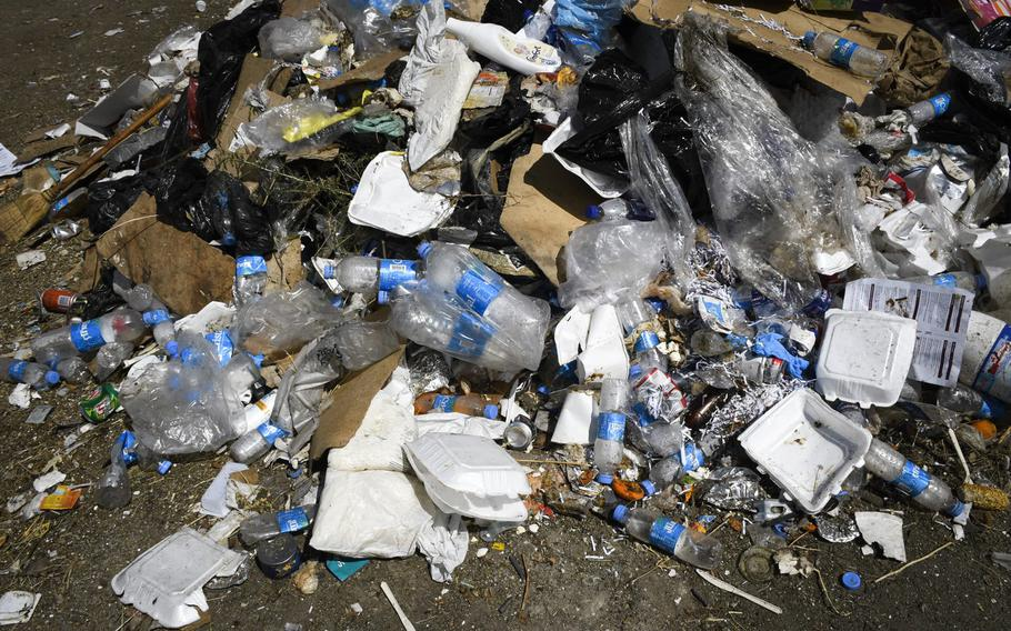 Trash from the U.S. Embassy accumulates at what the Afghan government says is an illegal dump, two miles east of the airport in Kabul, Afghanistan, on Aug. 17, 2020.