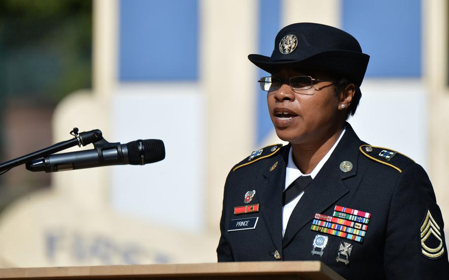 Sgt. 1st Class Tonya Prince sings the national anthems of the United States and Germany at the 9/11  remembrance ceremony hosted by the 21st Theater Sustainment Command in Kaiserslautern, Germany, Sept. 11, 2020.