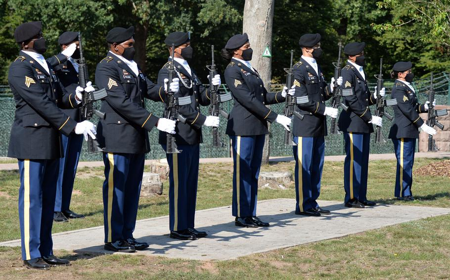 The firing detail stands at attention during the playing of taps at the  9/11  remembrance ceremony hosted by the 21st Theater Sustainment Command at Panzer Kaserne in Kaiserslautern, Germany, Sept. 11, 2020.