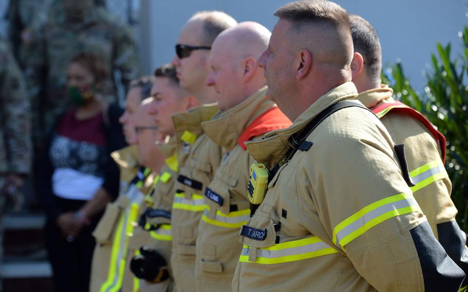 Members of the U.S. Army Garrison Rheinland-Pfalz fire department take part in the 9/11 remembrance  ceremony hosted by the 21st Theater Sustainment Command in Kaiserslautern, Germany, Sept. 11, 2020.