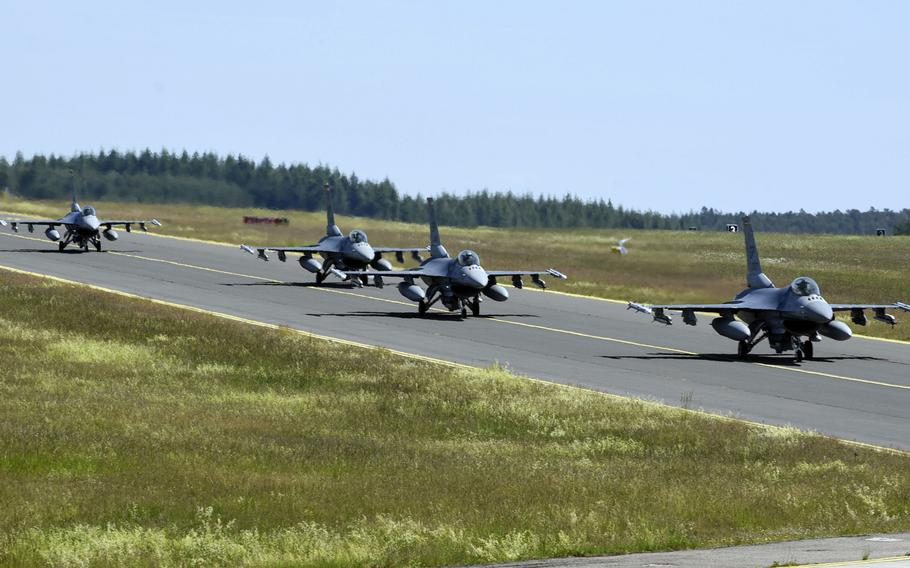 U.S. Air Force F-16 Fighting Falcons, assigned to the 480th Fighter Squadron, taxi at Spangdahlem Air Base, Germany, in May 2020. USAFE-AFAFRICA commander Gen. Jeffrey Harrigian said Monday, Sept. 14, 2020, that moving Spangdahlem's 480th Fighter Squadron from Germany to Aviano Air Base, Italy, could take some time.