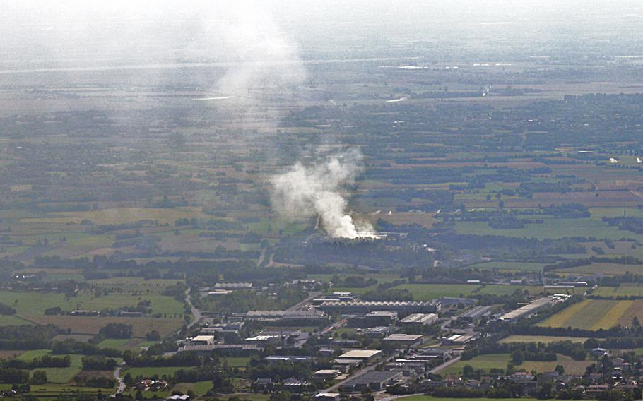 Smoke rises from a waste treatment plant about 6 miles from Aviano Air Base, Italy, on Sept. 20, 2020. Authorities on Friday lifted a warning to avoid touching grass and soil due to contamination fears from the fire, which burned for days.