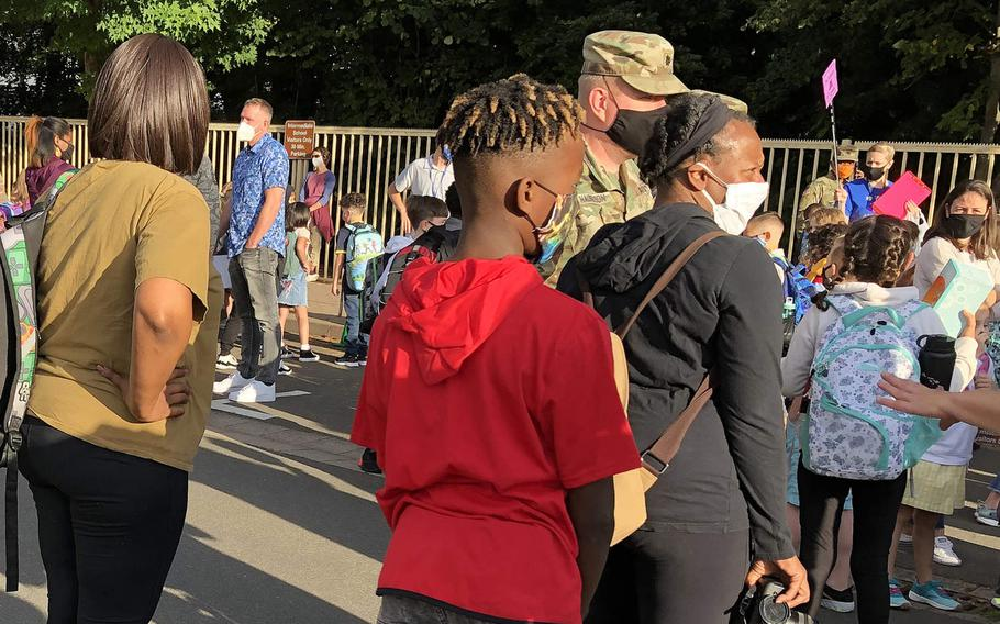 Ramstein Intermediate School students and parents lined up on the first day of school on Aug. 24, 2020, at Ramstein Air Base, Germany. The school announced Friday that it will close through Oct. 5 after three employees tested positive this week for coronavirus.