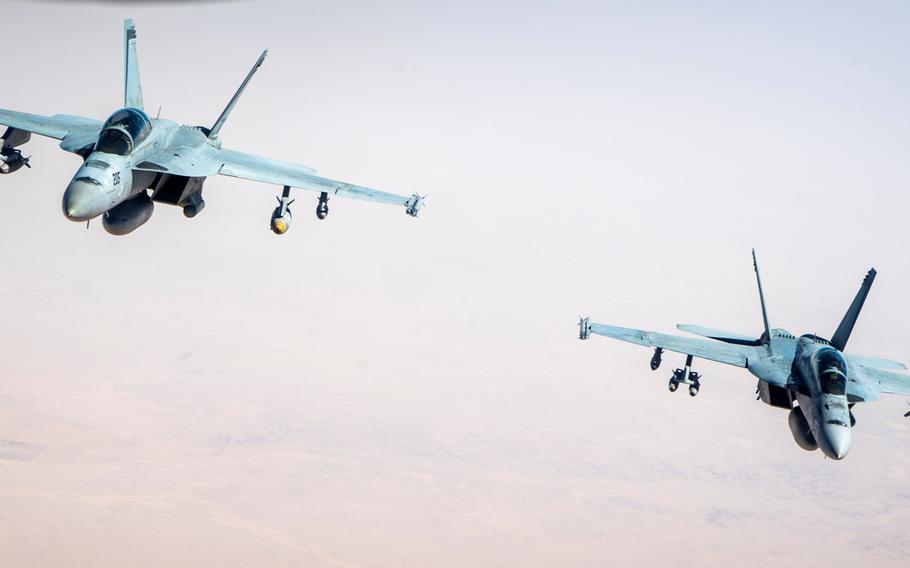 A pair of F/A-18F Super Hornets from Carrier Air Wing 17, USS Nimitz. For the first time in nearly 2 1/2 years, jets launched from an aircraft carrier conducted an airstrike against Islamic State targets in support of Operation Inherent Resolve, the global coalition battling the terrorist group in Iraq and Syria.