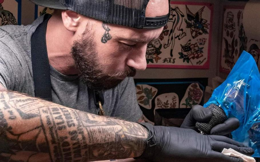 Mathias Moretti creates a tattoo for the first time at a shop on a U.S. military installation at American Tattoo Society on Nellis Air Force Base, Nev., Sept. 4, 2020.