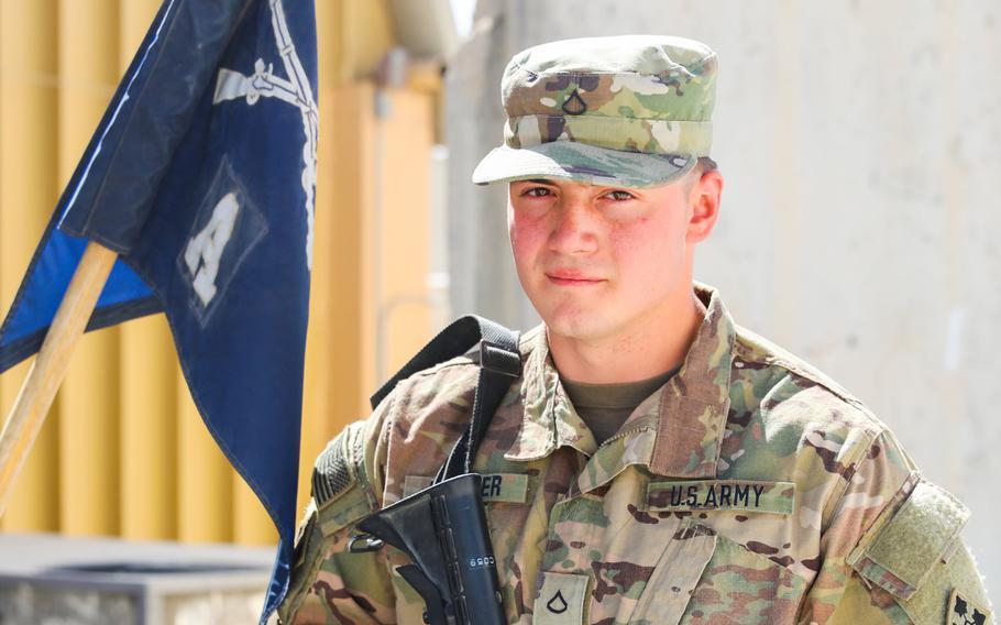 Pfc. Trenton Kreuger, an infantryman with 2nd Infantry Brigade Combat Team, 4th Infantry Division, poses for a photo in Kandahar, Afghanistan. Kreuger's father Michael Kreuger also served in Afghanistan.