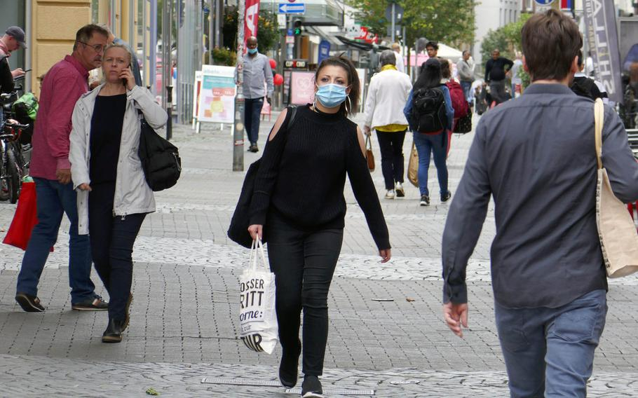 People walk down Marktstrasse in downtown Kaiserslautern, Germany in late August 2020. A spike in coronavirus cases in Kaiserslautern led health officials to raise the health alert for the city to the second-highest level on Oct. 9, 2020.