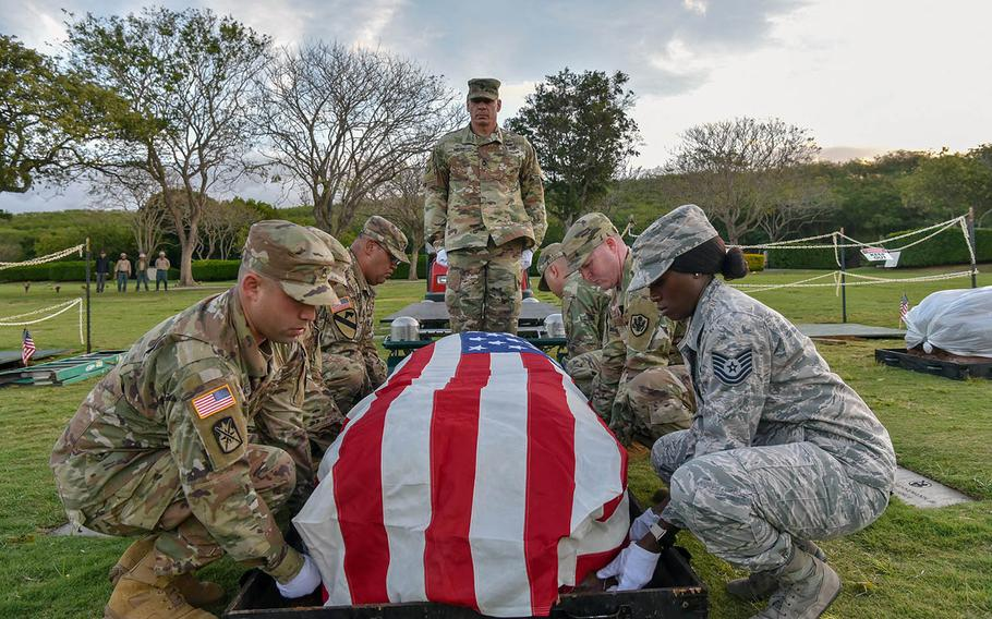 Service members assigned to the Defense POW/MIA Accounting Agency participate in a disinterment ceremony for a set of unknown remains at the National Memorial Cemetery of the Pacific, called the Punchbowl, in Honolulu, Hawaii, March 4, 2019.