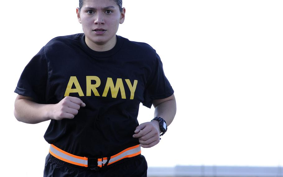 Sgt. Samantha Garcia stays focused on her breathing and pace as she runs during the Army Physical Fitness Test at the Greenlief Training Site, Neb., in 2017. The Army is surveying women in the force to help pick the best sports bras on the market to go into the standard clothing bag issue.