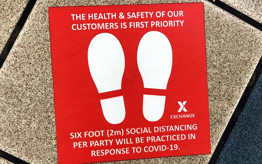 A floor decal reminds food court patrons to practice social distancing at Kadena Air Base, Okinawa, May 20, 2020.