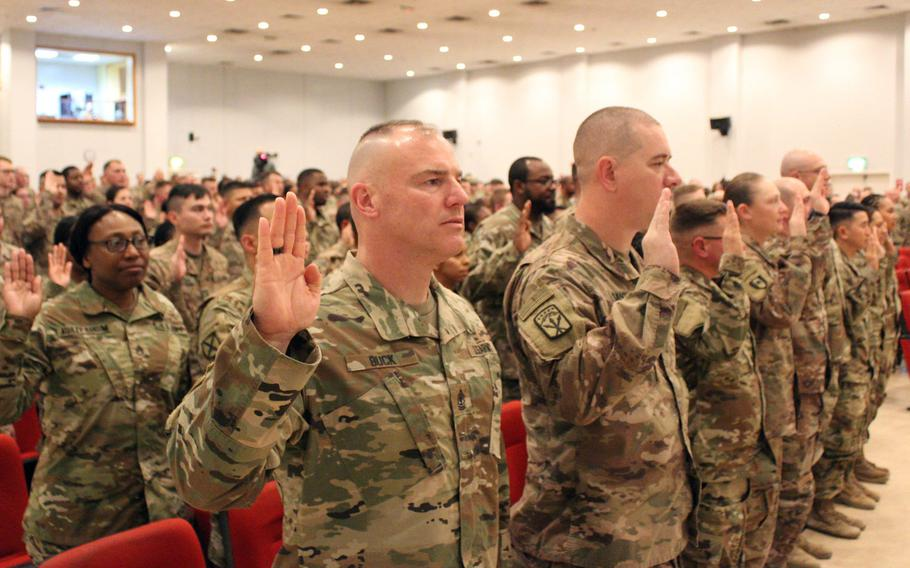 First Sgt. Joseph N. Buck Jr., 1173rd Deployment and Distribution Support Battalion, 595th Transportation Brigade, recites the noncommissioned officer creed alongside other soldiers during an NCO induction ceremony at Camp Arifjan, Kuwait, Feb. 9, 2019. Many NCOs, primarily in the ranks from staff sergeant through master sergeant, will be able to rank their desired next assignments under a new program.