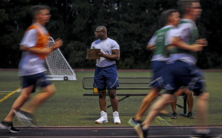 Senior Airman David Lawal monitors airmen during the 1.5-mile run of the U.S. Air Force Fitness Test at Hurlburt Field, Fla., Aug. 24, 2017. An Air Force Spark Tank proposal uploaded on Oct. 16, 2020, looks to eliminate the Air Force fitness test and replace it with monitored monthly fitness requirements.