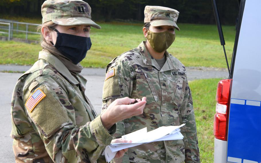 Cpt. Anna Schultz, left, and Sgt. Toni Weaver, both with the Vilseck Veterinary Treatment Facility, give instructions during an exercise in Vilseck, Germany, Oct. 20, 2020. The 7th Army Training Command announced new coronavirus travel restrictions for soldiers in the Bavaria footprint, including Vilseck, as the virus resurges across Europe.