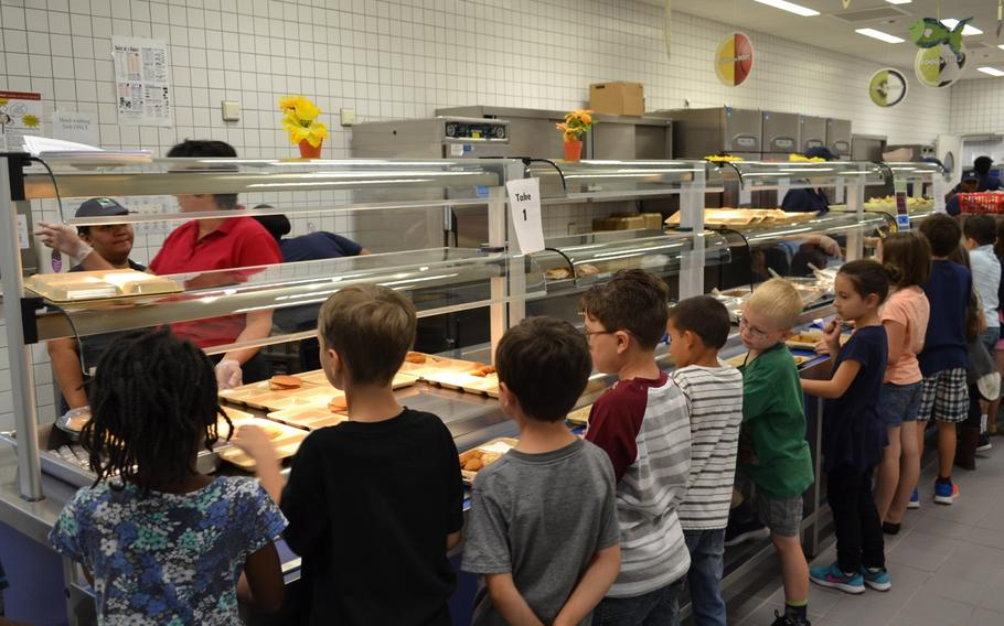 Students line up for lunch at Netzaberg Elementary School, Germany, in 2016. The Department of Defense Education Activity will provide free lunches to all overseas students beginning Nov. 2, 2020.