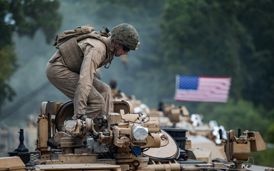 A Marine with 2nd Tank Battalion, 2nd Marine Division, prepares to depart from a tank lot on Camp Lejeune, N.C., July 27, 2020.
