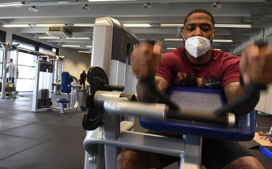Army Staff Sgt. Kenric Duncan, 31, works his triceps on a machine Monday, June 15, 2020, at the Southside Fitness Center on Ramstein Air Base, Germany. As new restrictions take effect in Germany Nov. 2, several on-base gyms will remain open for active-duty personnel.