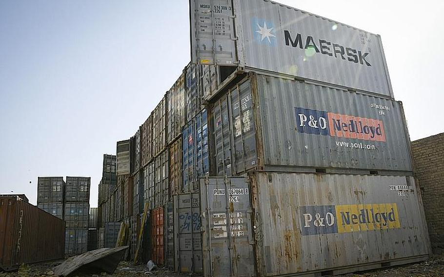 Shipping containers pile high at a bazaar in southern Afghanistan where goods that once belonged to U.S. and NATO troops and contractors at Kandahar Airfield are sold to locals. Empty containers sell for about $800 and can be used as shops or offices, a local vendor said.