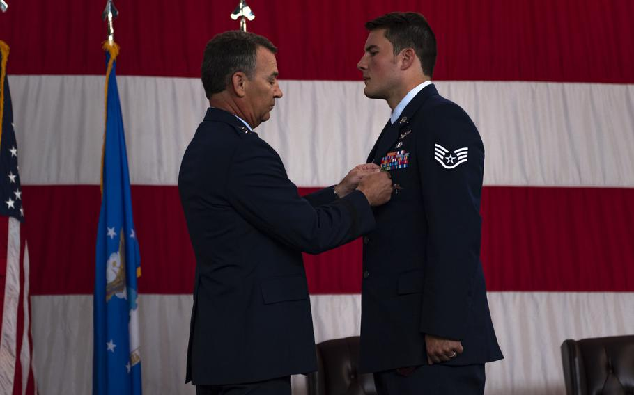 Air Force Maj. Gen. Chad P. Franks, commander of the 15th Air Force, pins a Silver Star Medal to the chest of Staff Sgt. Nicholas Brunetto, a pararescueman with the 38th Rescue Squadron, during a ceremony at Moody Air Force Base, Ga., on Oct. 29, 2020.