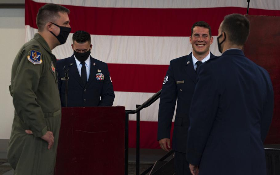 Airmen assigned to the 23rd Wing talk with Staff Sgt. Nicholas Brunetto, a pararescueman with the 38th Rescue Squadron, after he received a Silver Star Medal during a ceremony at Moody Air Force Base, Ga., on Oct. 29, 2020.