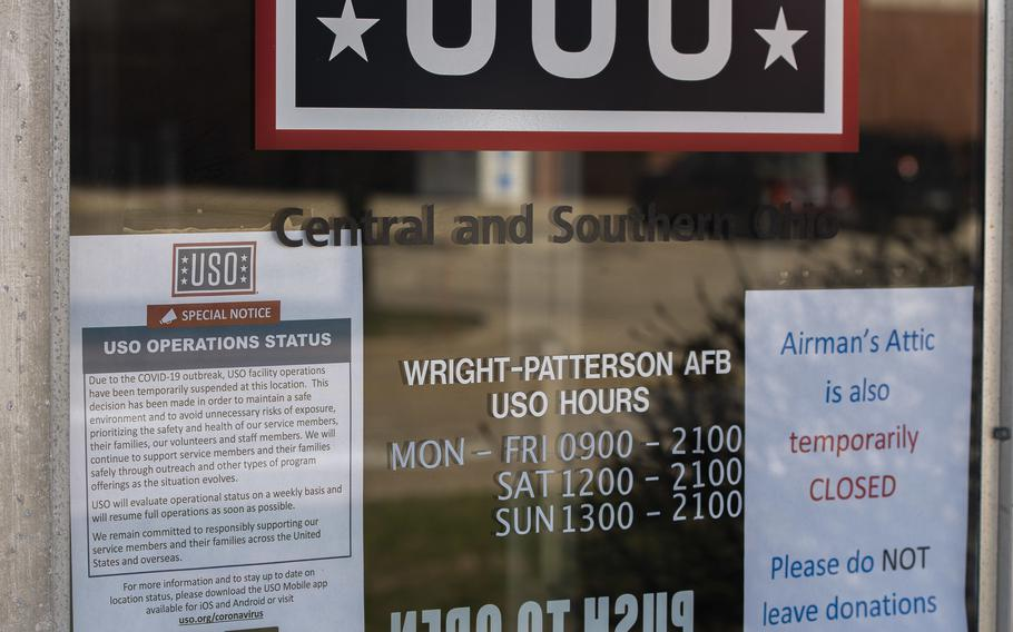 Signs alert customers of the USO and Airman's Attic closure due to COVID-19 at Wright-Patterson Air Force Base, Ohio, March 25, 2020. In an effort to reduce the spread of COVID-19 during the pandemic, these offices were closed until reopening again can be done safely.