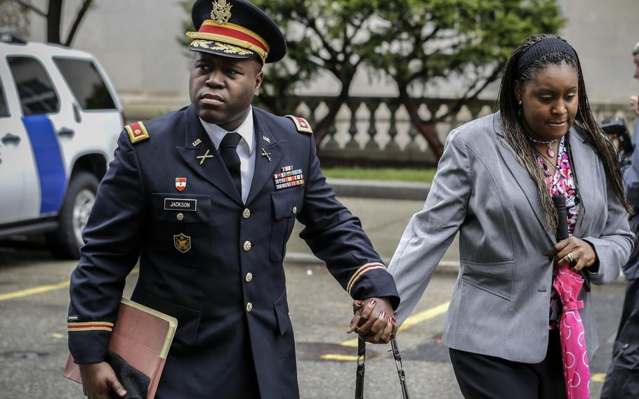This Thursday May 9, 2013, file photo shows John Jackson, left, and Carolyn Jackson, right, leaving court in Newark, N.J.