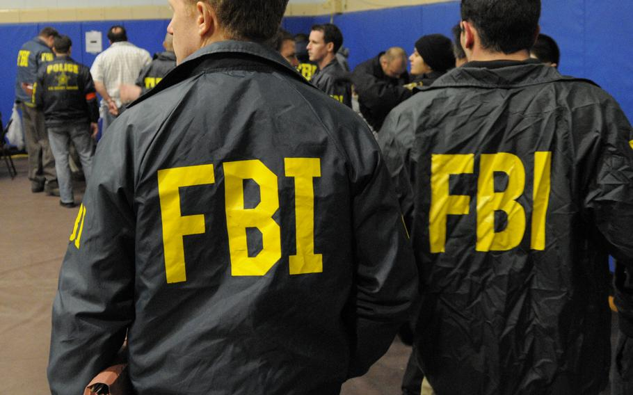 FBI agents are shown during processing in Brooklyn, N.Y. in this January 2011 file photo.
