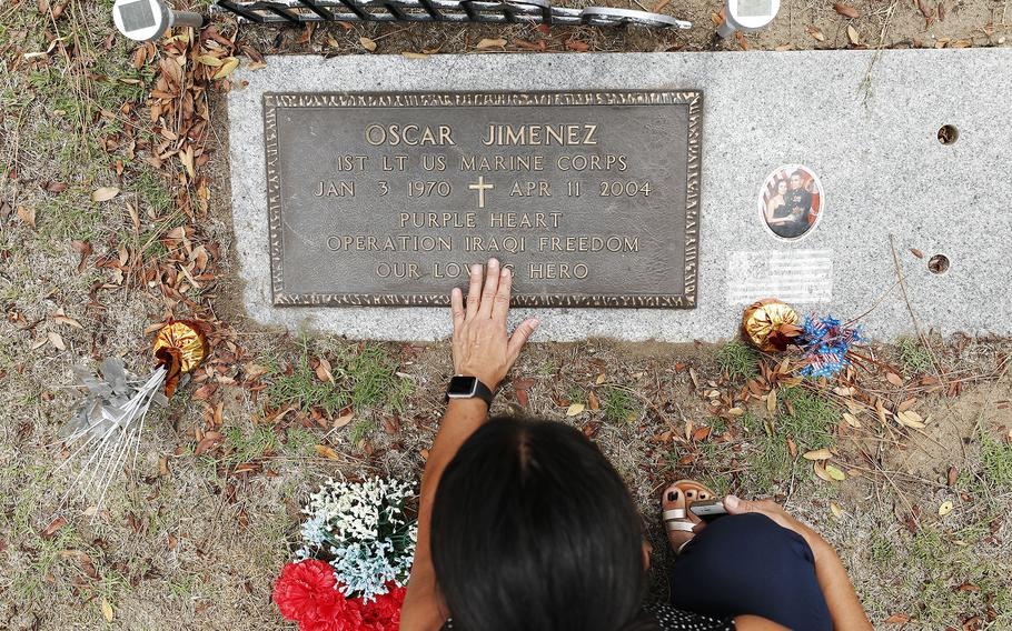 Sonia Jimenez visits the grave of her late brother Oscar Jimenez at Greenwood Memorial Park on Sunday, August 15, 2021, in San Diego, CA. 1st Lt. Oscar Jimenez, 34, was killed in an ambush while serving near Fallujah, Iraq in 2004 .