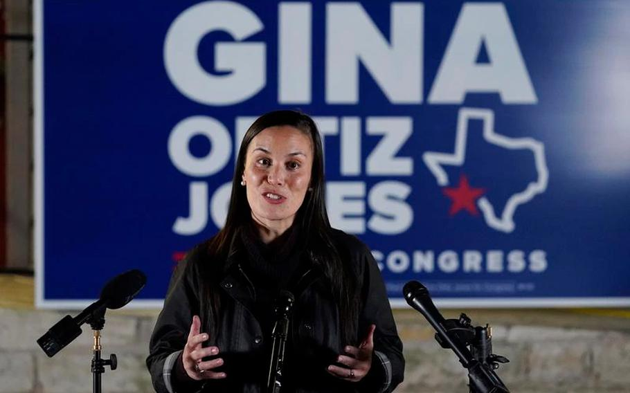 Democratic congressional candidate Gina Ortiz Jones talks with the media outside of her campaign headquarters, Tuesday, Nov. 3, 2020, in San Antonio.