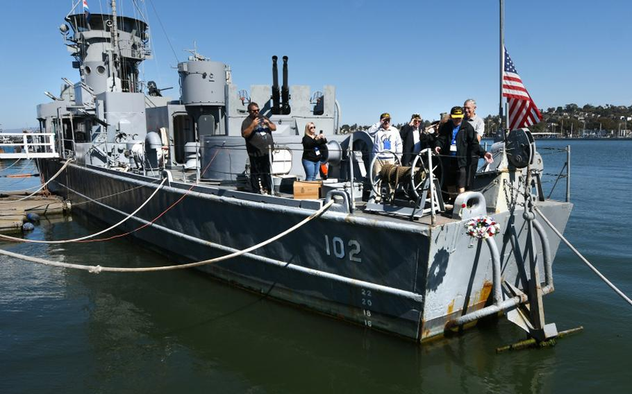 Veteran Ed Desmond tosses a memorial wreath off the back of the USS LCS 102 during the Landing Craft Support Museum 7th Annual Convention Memorial Service on Mare Island on Wednesday, Sept. 30, 2021.