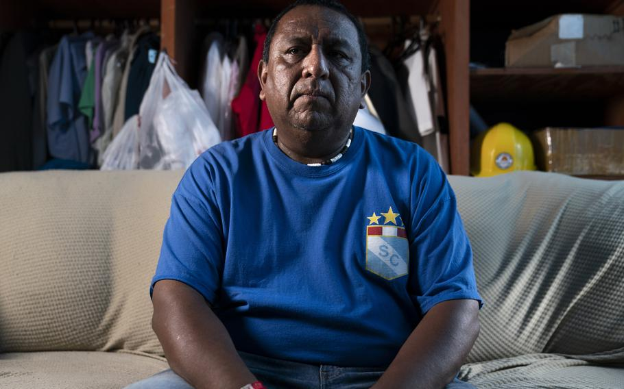 Franklin Anchahua-Herrera sits for a portrait in a room that he shares with his father, Tuesday, Aug. 17, 2021, in the Queens borough of New York. Anchahua-Herrera has several health conditions certified by the World Trade Center Health Program that are approved for treatment benefits for individuals who worked at the site in the aftermath of the 9/11 terrorist attacks.