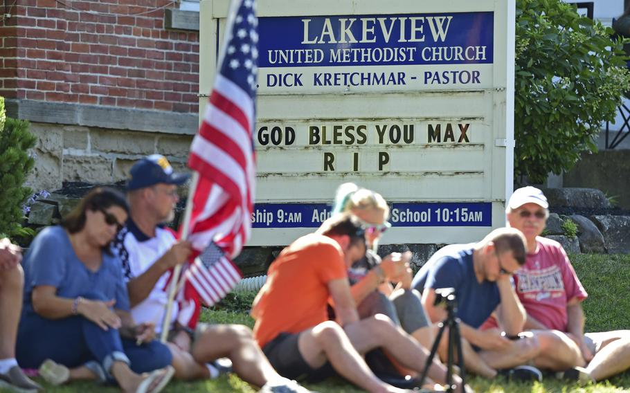 People line the streets Lakeview United Methodist Church before the procession for Navy Corpsman Maxton Soviak, Wednesday, Sept. 8, 2021, in Berlin Heights, Ohio. Soviak was one of 13 U.S. troops killed in a horrific suicide bombing at Afghanistan's Kabul airport on Aug. 26.