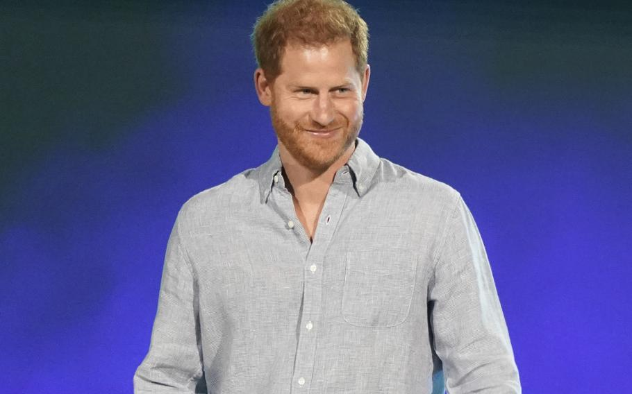"""In this May 2, 2021, file photo, Prince Harry, Duke of Sussex, speaks at """"Vax Live: The Concert to Reunite the World"""" in Inglewood, Calif. Prince Harry took a break from paternity leave to """"spread the news"""" about his Invictus Games. The Duke of Sussex announced in an Instagram post Wednesday, June 9, 2021, that the Invictus Games will take place in Düsseldorf, Germany, in 2023."""
