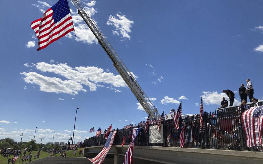 Thousands of people lined Interstate 70 in suburban St. Louis Wednesday, Sept. 8, 2021, for a procession taking Lance Cpl. Jared Schmitz's remains to a funeral home in St. Charles, Missouri. Schmitz died in the suicide bombing last month in Afghanistan.
